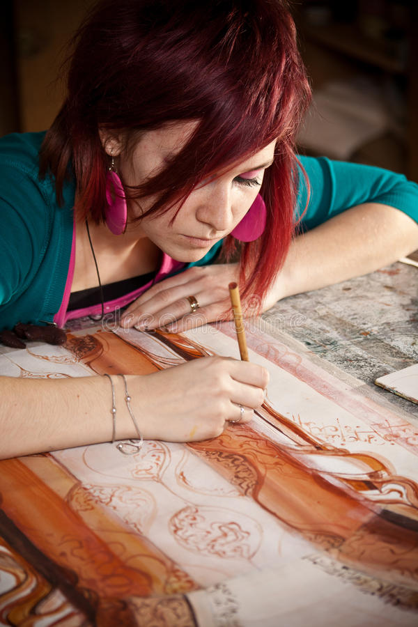Young female artist stock photography