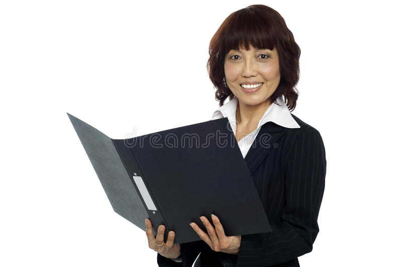 Download Young Female Asian Boss Going Through The File Stock Photo - Image: 26509868