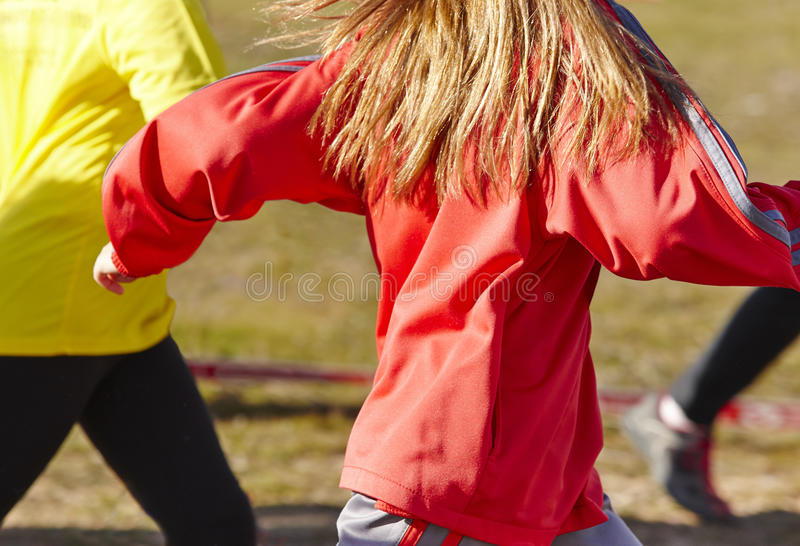 Young female athletics runners on a race. Outdoor circuit. Horizontal stock photos