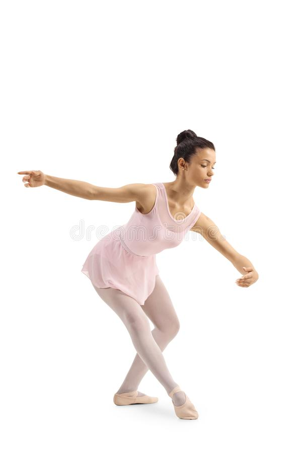 Young female ballet dancer performing a classical pose stock photo
