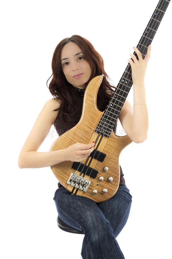 Young female bass guitarist royalty free stock images