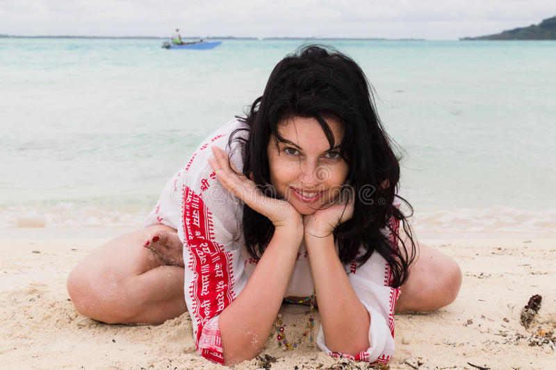 Young female on the beach royalty free stock images