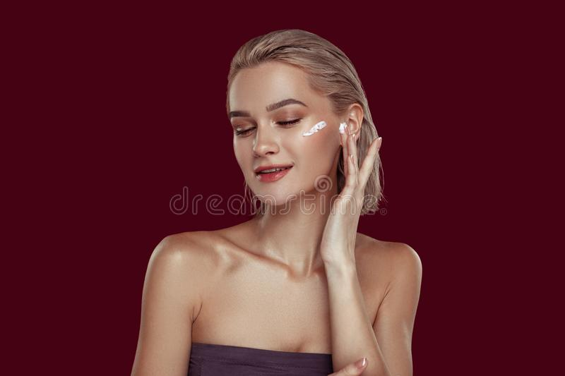 Young female beauty blogger promoting famous cosmetics stock images