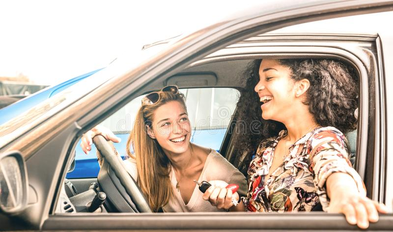 Young female best friends having fun at car roadtrip moment - Transportation concept and urban ordinary life. With women girlfriends at happy travel vacation on royalty free stock photos