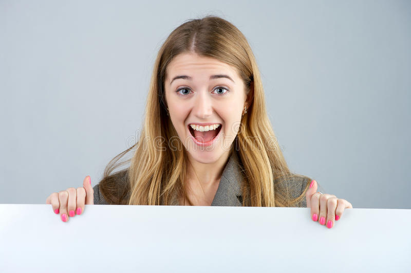 Young female with blank bill board royalty free stock photo