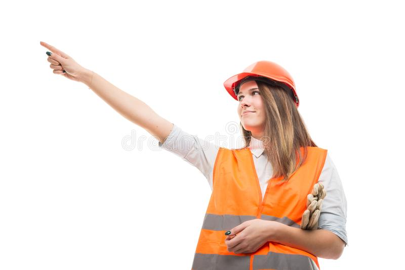 Young female builder pointing for something stock image