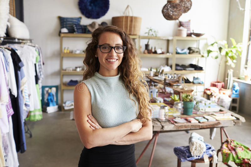 Young female business owner in a clothes shop, portrait stock photography