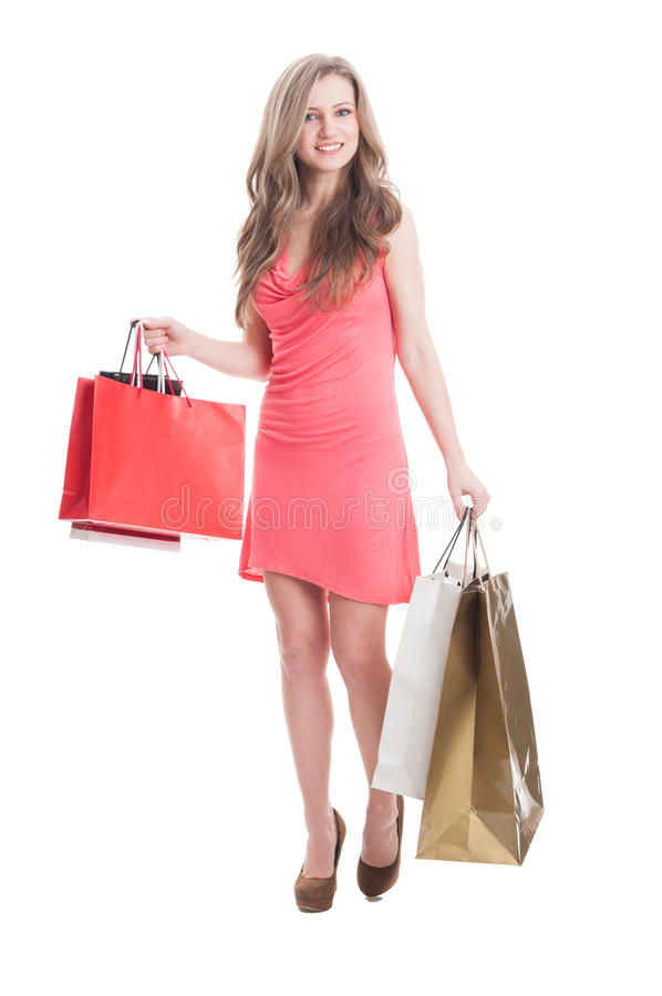 Young female carrying shopping bags royalty free stock image