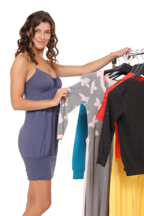 Young female choosing clothes royalty free stock photo