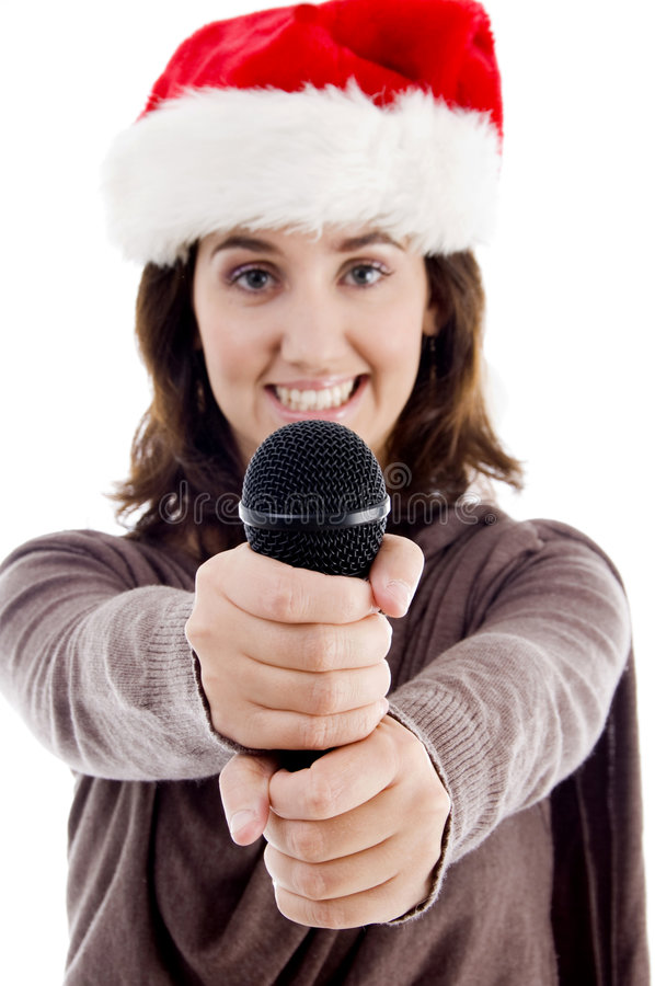 Young female in christmas hat singing royalty free stock photography