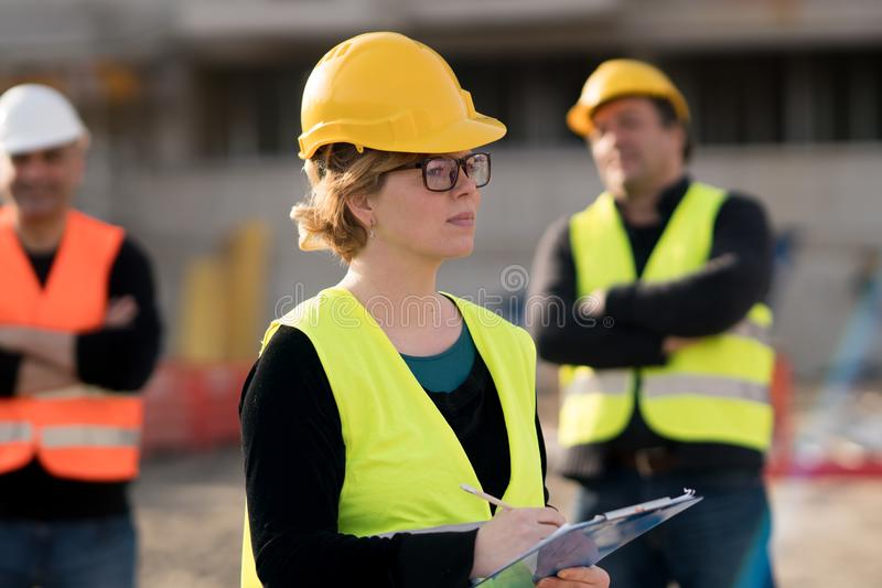 Female civil engineer at work on construction site. Young female civil engineer at work on construction site stock photos