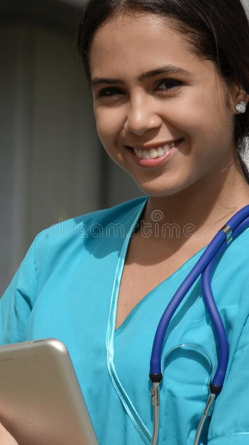 Minority Girl Happy Nurse. A young female Colombian teen royalty free stock photos