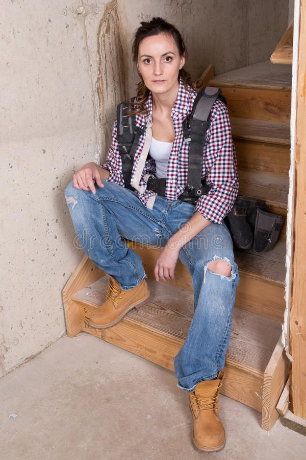 Young female contractor with carpenter equipment royalty free stock photos