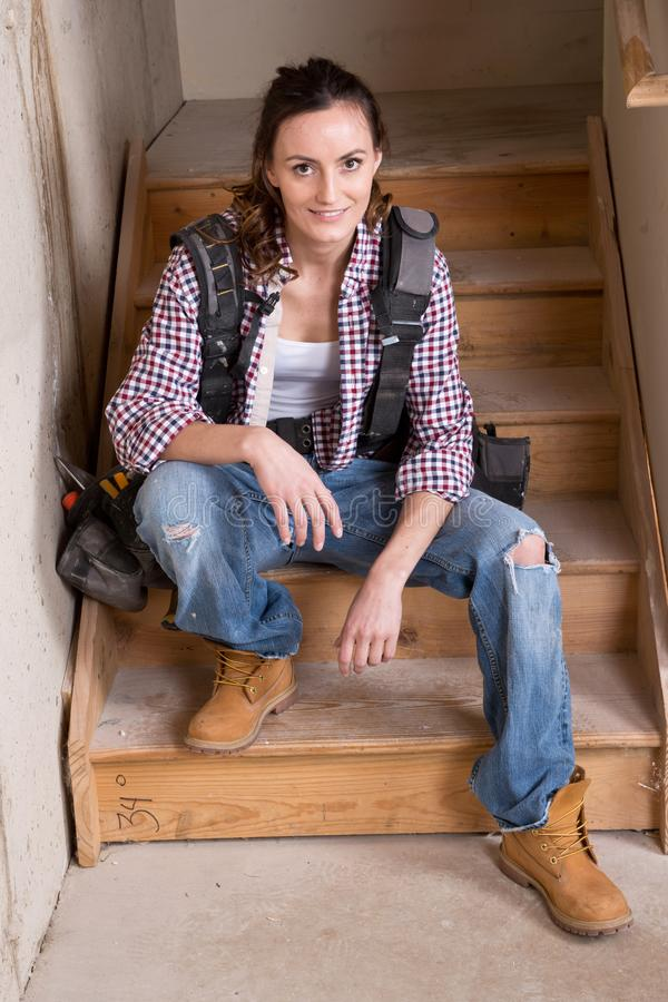 Young female contractor with carpenter equipment royalty free stock photography