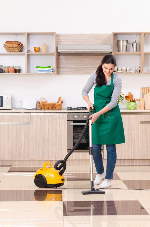 The young female contractor doing housework. Young female contractor doing housework stock photo