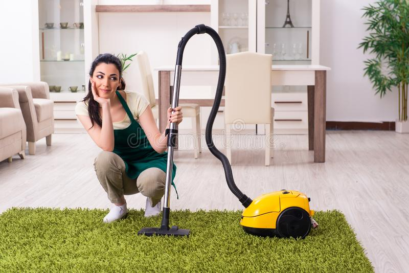 Young female contractor doing housework. The young female contractor doing housework stock photos