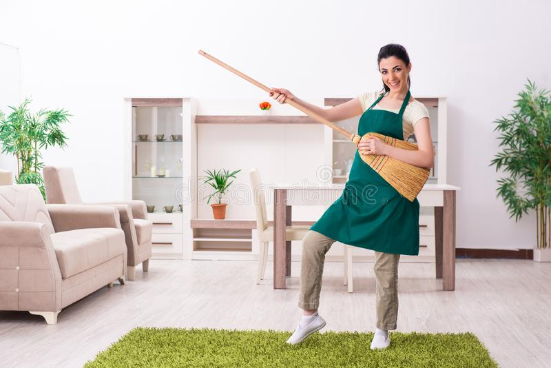 The young female contractor doing housework. Young female contractor doing housework stock image