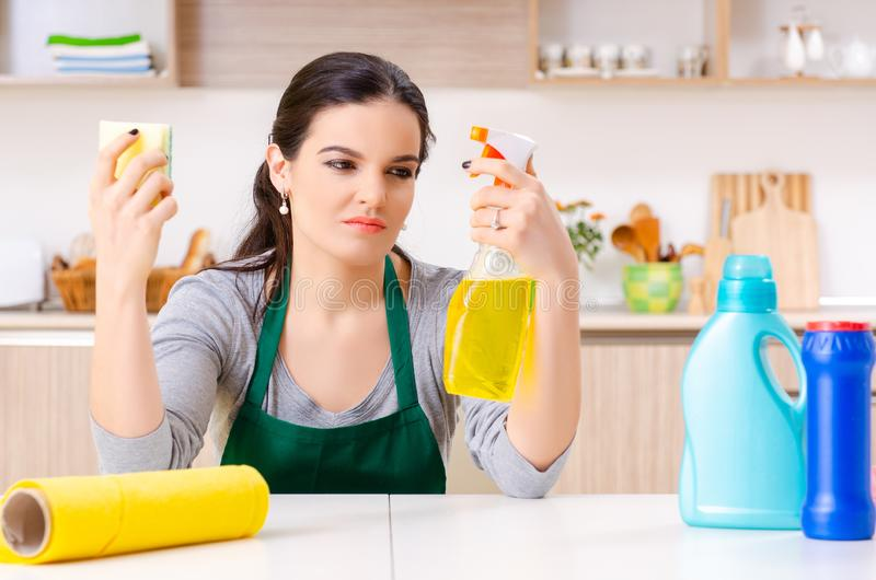 Young female contractor doing housework. The young female contractor doing housework royalty free stock photo
