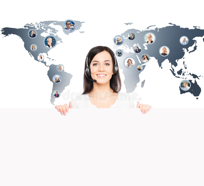 Young female customer support operator on a world map stock images