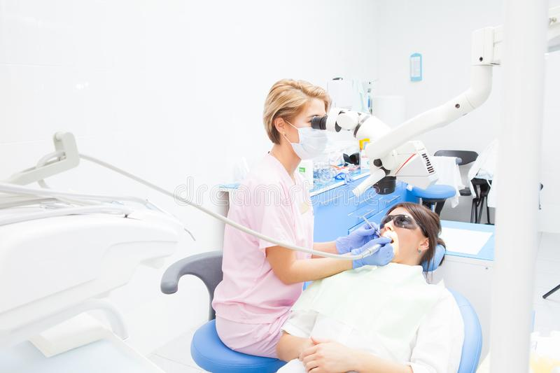 Dentist wearing mask and gloves stock image