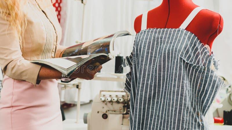 Designer with fashion magazine royalty free stock image