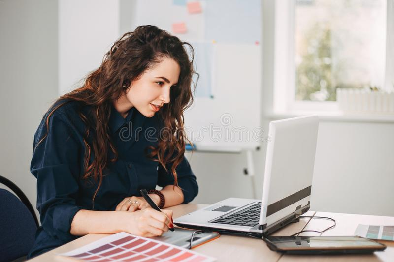 Female designer drawing working with color samples royalty free stock images