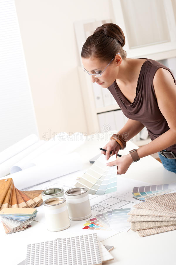 Young female designer working with color swatches. Young female designer working at office with color swatches royalty free stock photos