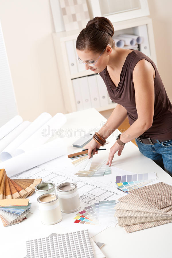 Young female designer working with color swatches. Young female designer working at office with color swatches stock image