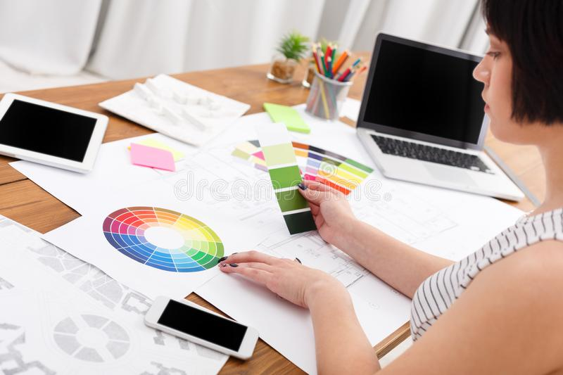 Designer`s working table with color palette stock photography