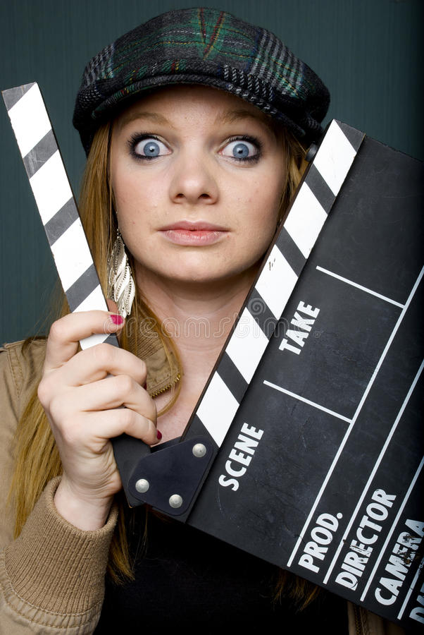 Young Female Director With Slate Staring At Camera Stock Photos