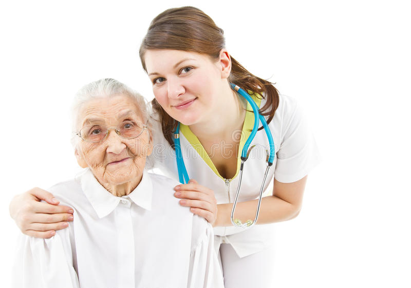 Doctor taking care of an old lady stock photos