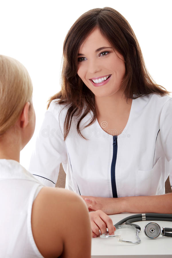 Young Female Doctor With Female Patient. Royalty Free Stock Photo