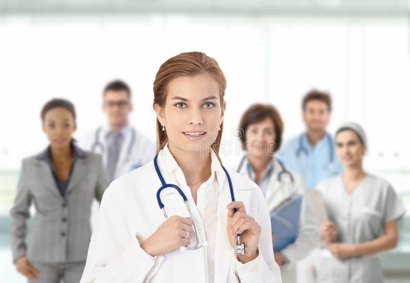 Young female doctor in front of medical team stock photos