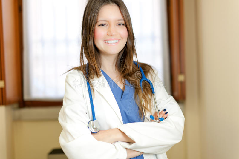 Young female doctor in her studio stock image