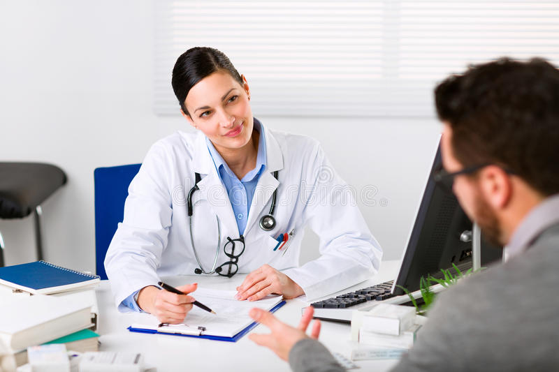Young female doctor listening intently royalty free stock photos