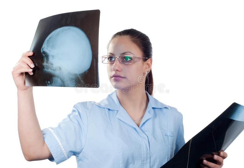 Download Young Female Doctor Looking At X-ray Picture Stock Image - Image: 24838689