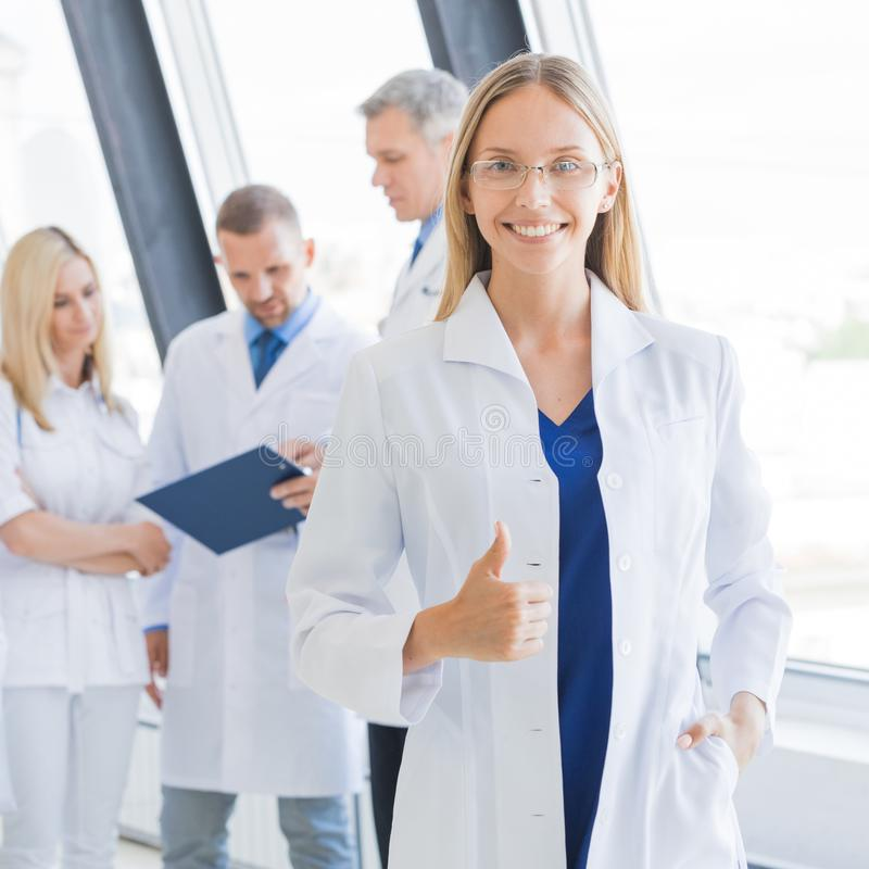 Medical team in hospital. Young female doctor and medical team in hospital royalty free stock image