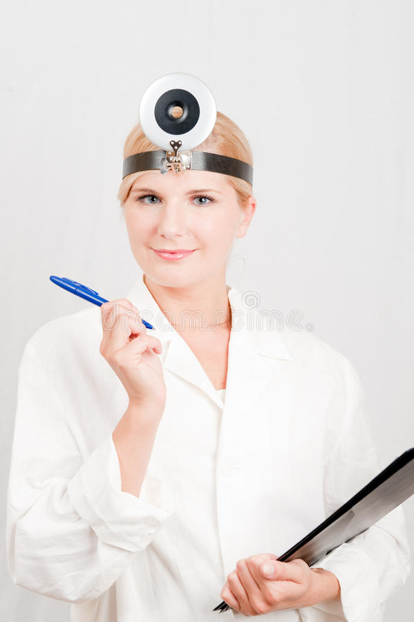 Young female doctor with a notes in white uniform stock photos