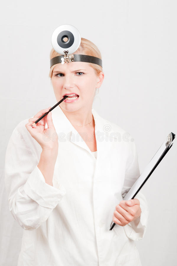 Young Female Doctor With A Notes In White Uniform Royalty Free Stock Photography