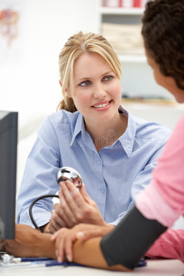 Young female doctor with patient royalty free stock photos