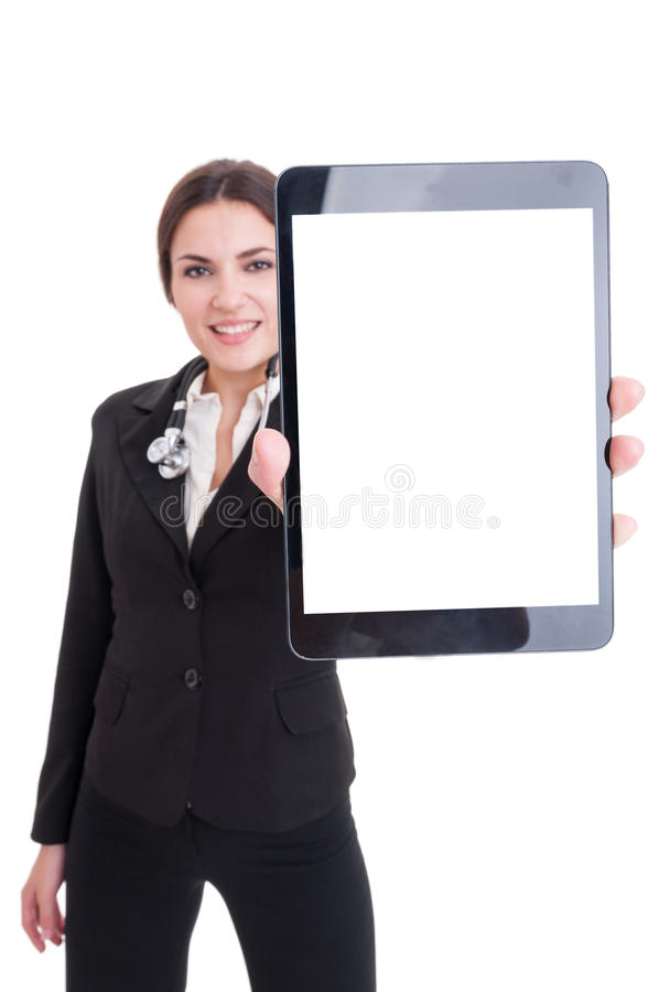 Young female doctor showing tablet with blank screen or display. As copy space and advertising area stock photography
