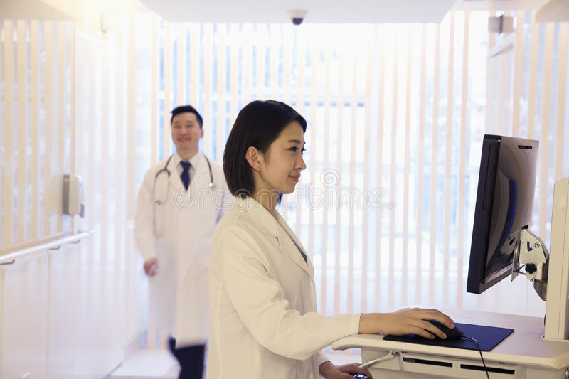 Young female doctor using the computer in the hospital, Beijing, China stock photos