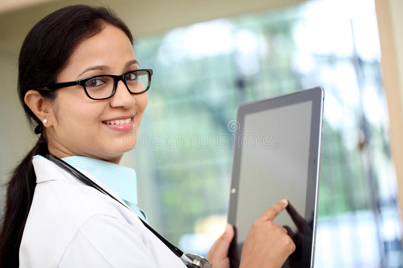 Young female doctor using tablet computer royalty free stock photos