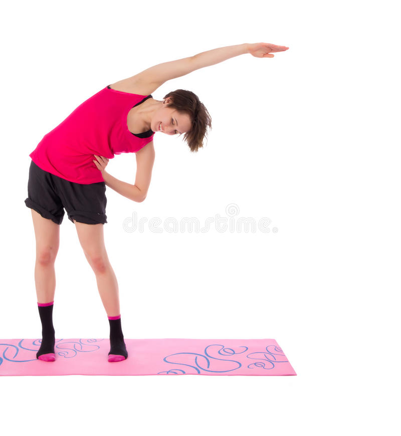 Young female doing exercise on the mat stock photo