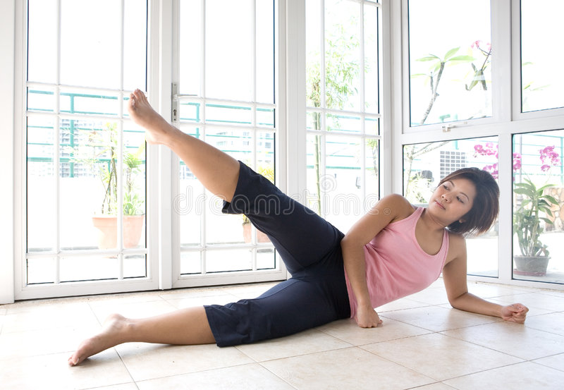 Download Young Female Doing Leg Raises As Part Of Exercise Stock Photo - Image: 5296156