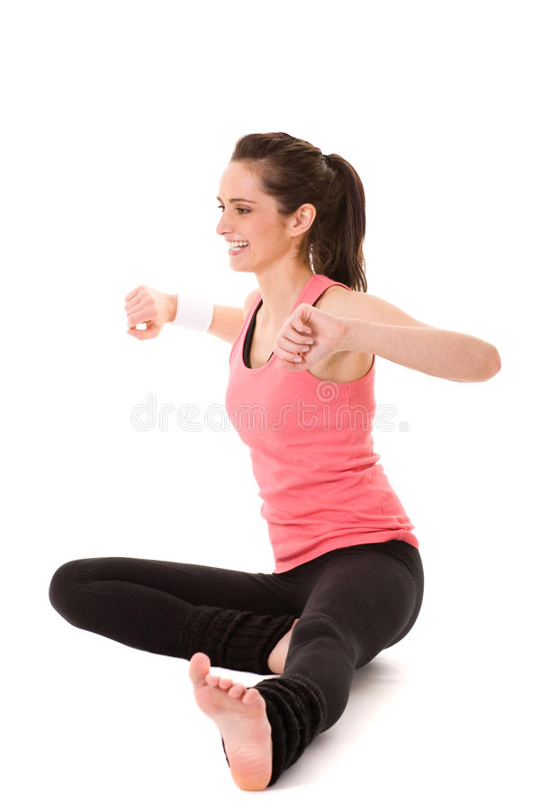 Young female doing some exercises on white floor stock photos