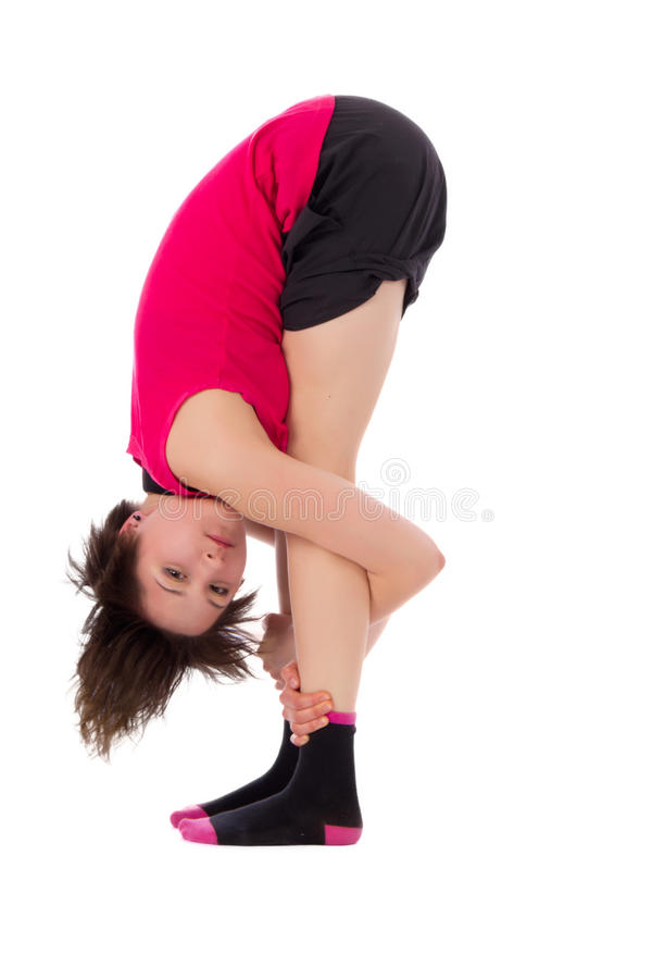 Young female doing yoga exercise royalty free stock photos
