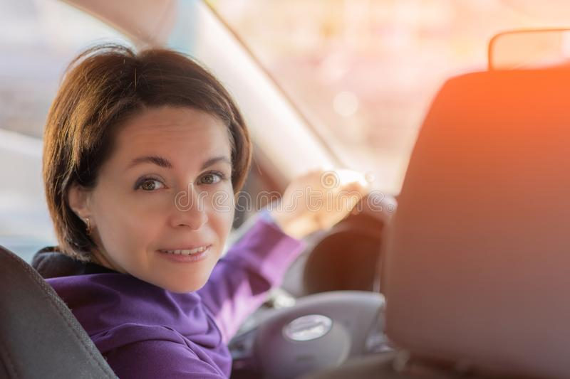 Young Female Driving Car on Highway in Country During summer. Backseat View stock images