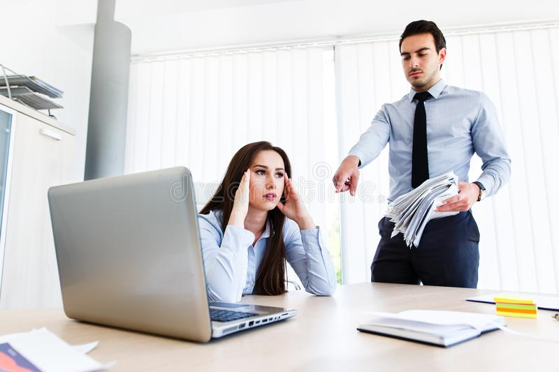 Young female employee has a lot of unsolved tasks royalty free stock photos