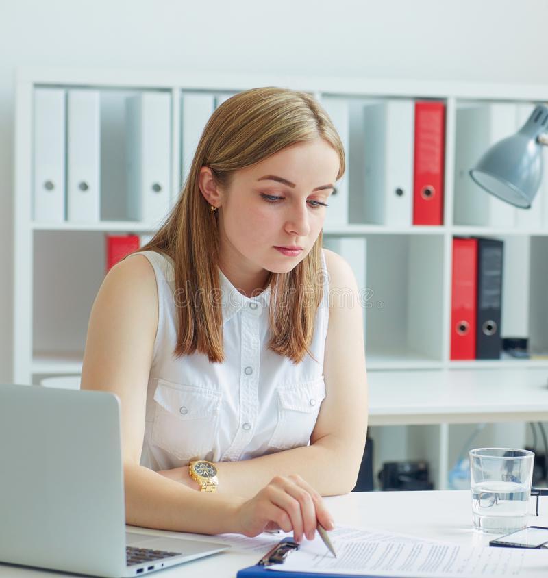 Young female employee of the staffing agency helps fill out the form. stock photo